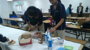 Members making waffles