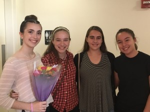 Emma Seeger receiving flowers after one of her performances